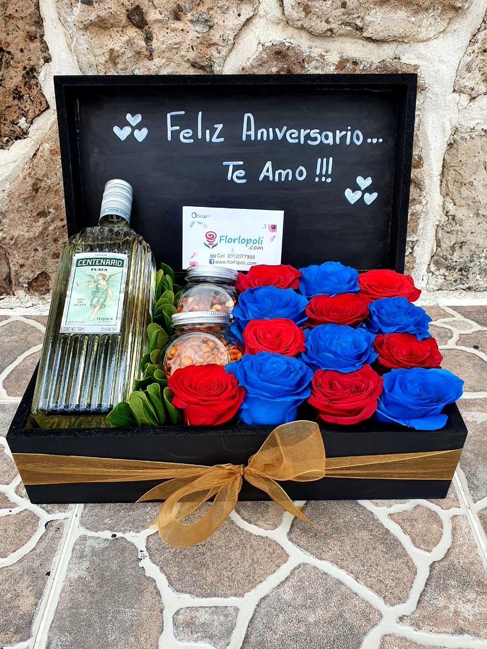 Caja de rosas rojas y rosas azules con tequila